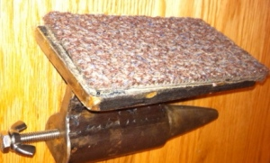 thick industrial carpet, cut from who knows what salvaged item,  ensures that all my blows are gentle on the ears  and that the anvil won't go flying!