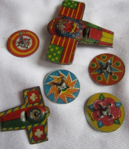 gorgeous tin toys--small tops and planes.  not sure if they were in cracker jack boxes but still amazing treasures