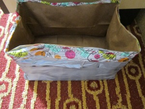 Paper bags, duct tape, washi tape--a sturdy impromptu catchall is born