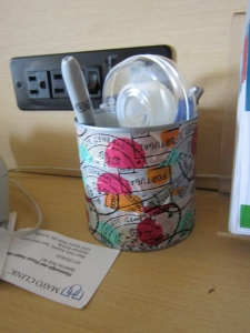 Tin can wrapped with colorful tape.  Eco-simple!